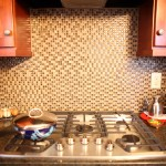 New glass tile backsplash and cooktop in a kitchen remodel