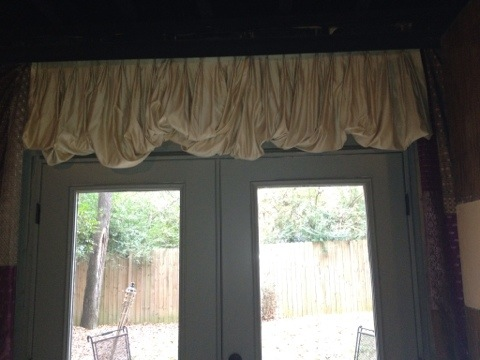 French doors opening to the backyard