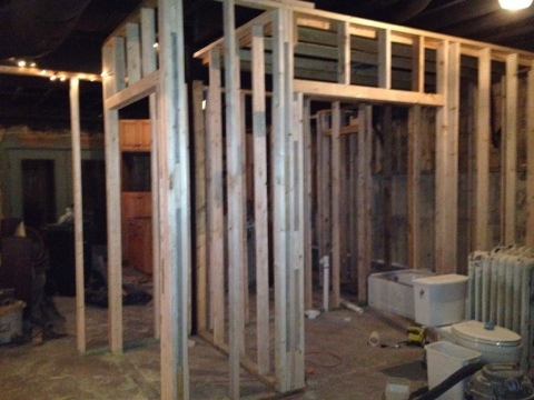 Framed walls for the basement and main closet.  The bathroom acts a room divider between the kitchen/ living area and bedroom.