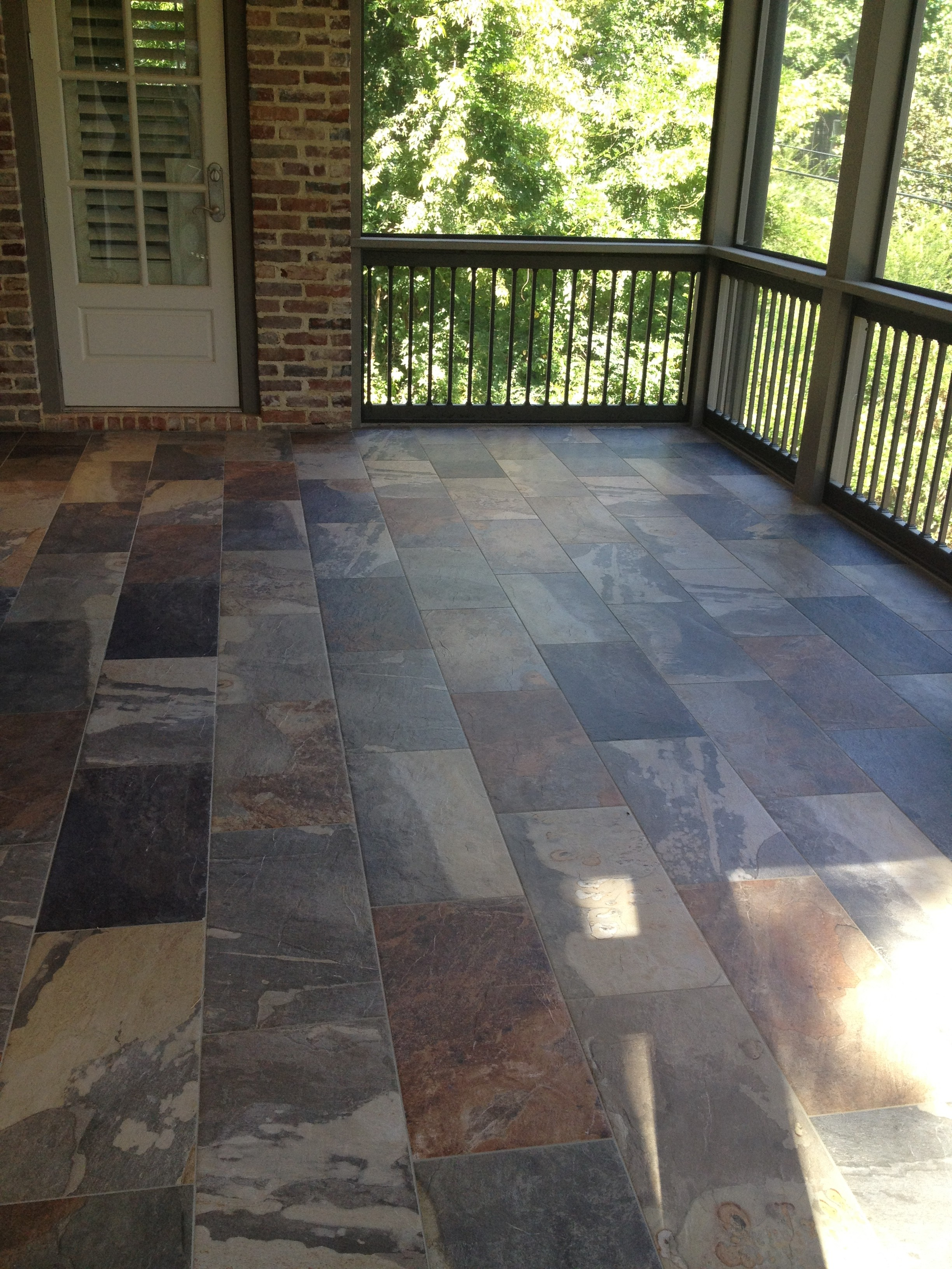 Beautiful exterior rated porcelain tile on screened in porch