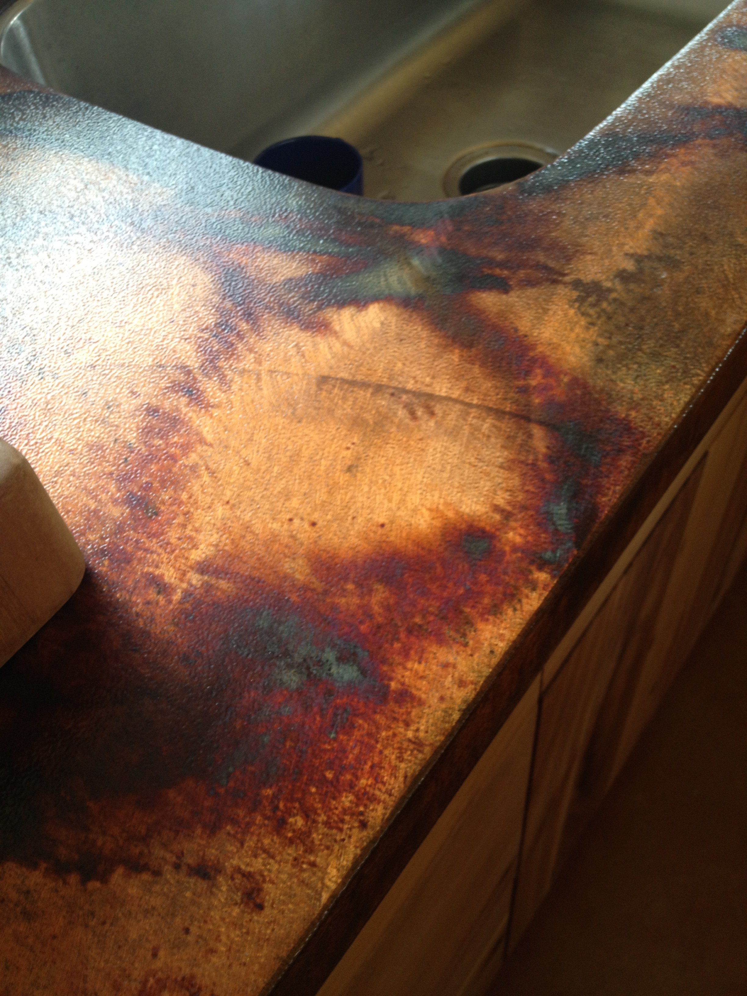 Oxidized steel countertop- beautiful and only $44/ square foot!